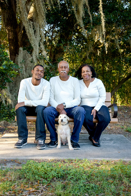 Family posing with their dog in Florida Park